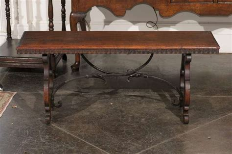 bench in spanish baroque revival spanish wooden bench with lyre shaped legs