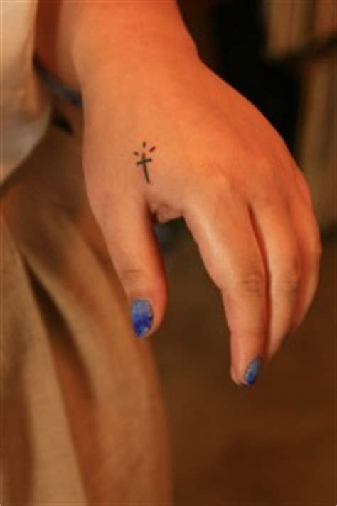cross tattoo on left hand meaning little size black cross tattoo on left hand tattooshunt com