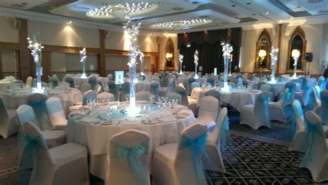 Wedding Venue Dressing, chair covers, centrepieces in