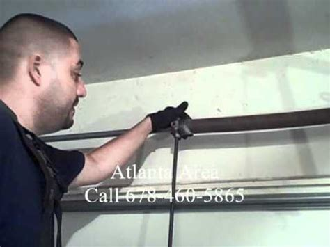 Removing Torsion Garage Door by Garage Door Torsion Repair Diy Dangers Of