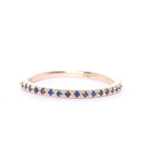 gold and gemstone half eternity ring by xissjewellery