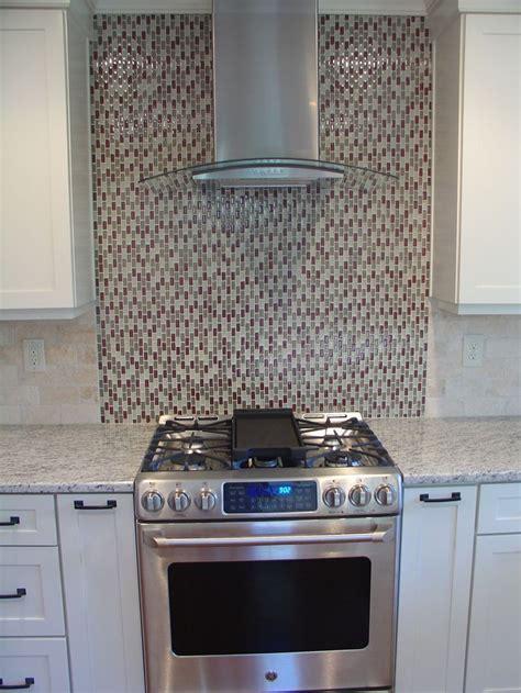 Kitchen Renovation   Chimney hood vent and glass tile