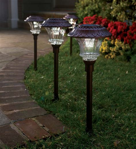 Patio Lighting Solar Set Of 4 Steel And Glass Encased Solar Led Path Lights
