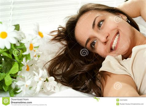 girl lying bed with flowers young caucasian girl lying in bed with flowers stock