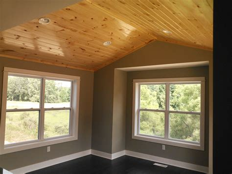 dining room with knotty pine ceiling built by armstrong builders of rockford mi the gray
