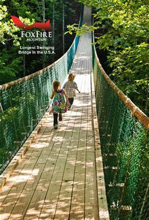 swinging bridge hotel kids play on america s longest swinging bridge picture