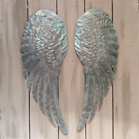 Metal Wings Wall Decor by Large Metal Wings Wall Decor Distressed Silver