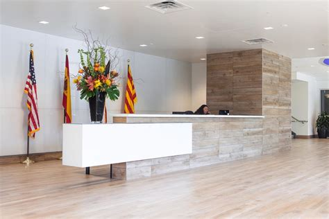 Tiled Reception Desk by A Sleek Tile And Glass Reception Desk Architects And