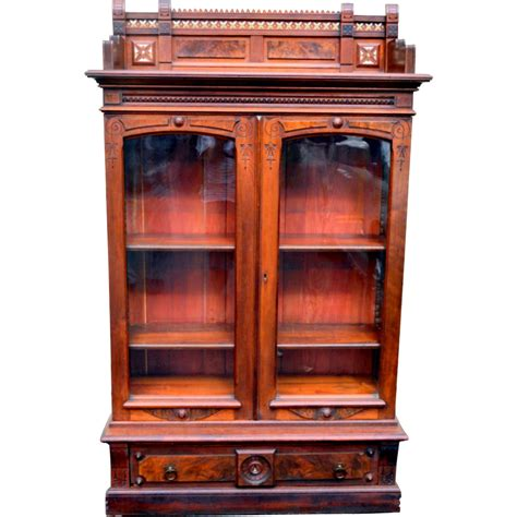 bookcase armoire eastlake walnut bookcase cabinet front porch antiques