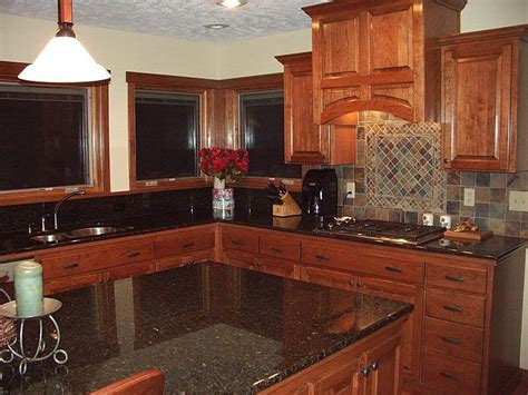 cherry wood kitchen cabinets with black granite cherry kitchen cabinets with granite countertops wooden