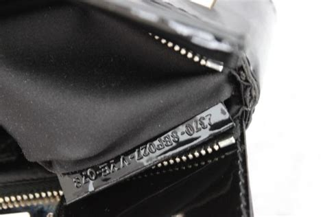 Fendi Crossword Clutch by Fendi Black Silver Patent Leather Crossword Clutch At