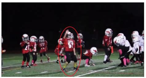 little league football players as the music starts these football players do something