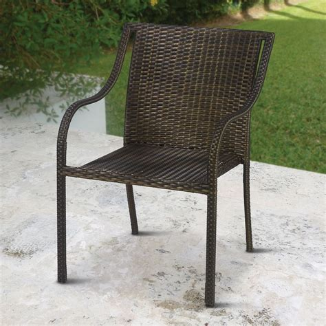 outdoor wicker armchair the stackable outdoor wicker chairs hammacher schlemmer