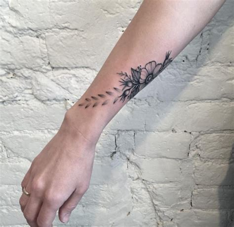 flower tattoo around wrist 50 amazing wrist tattoos for tattooblend