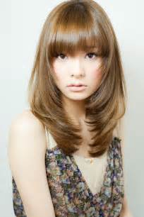 framed hairstyles with bangs long straight light brown with face framing layers and