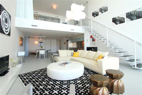 wonderful living room in miami duplex with grey sofa brown modern interior design by noha hassan from new york