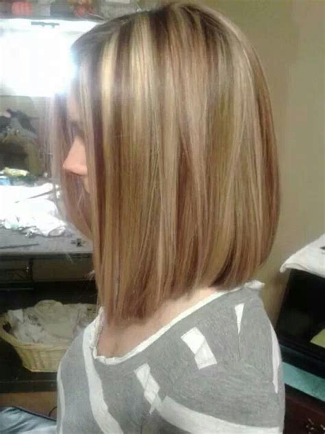 bob hair with high lights and lowlights long bob with red lowlights blonde highlights hair