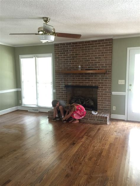 painting your brick fireplace white painting our brick fireplace white emily a clark