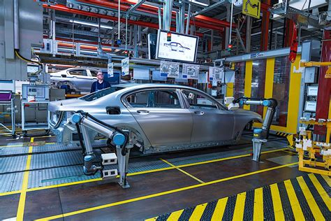 bmw factory assembly line bmw forced to stop production in china and south africa