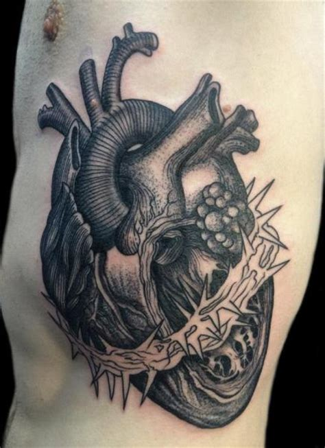 heart side dotwork tattoo by tin tin tattoos