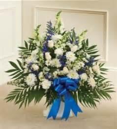 send sympathy funeral flowers in wellington fl blossom blue white sympathy floor basket funeral sympathy in crestview fl the flower basket florist
