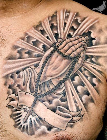 praying hands chest tattoo 1000 images about religious tattoos on