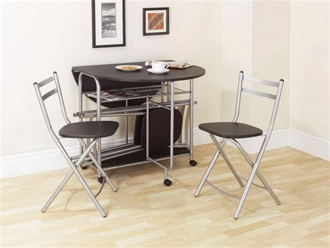 Drop Leaf Table And Folding Chairs Black Wooden And Silver Steel Drop Leaf Dining Table With Two Matching Folding Chairs On Beige