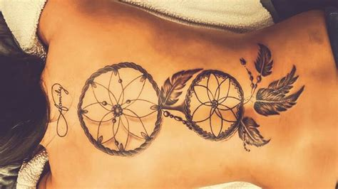dreamcatcher tattoo down back dream catcher back tattoo simple but beautiful obsessed