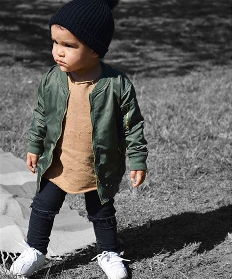 boys fall fashion on pinterest picture of black ripped jeans a tan shirt an olive green
