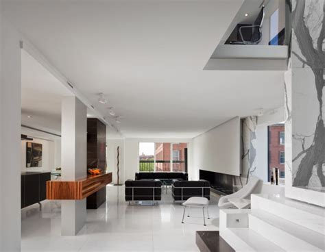 a dark two level space gets a dramatic renovation