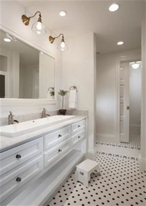 sink in bedroom one sink two faucets and lighting fixture design in