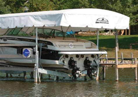 best pontoon boat lifts the best boat lift shore station vs hydrohoist vs