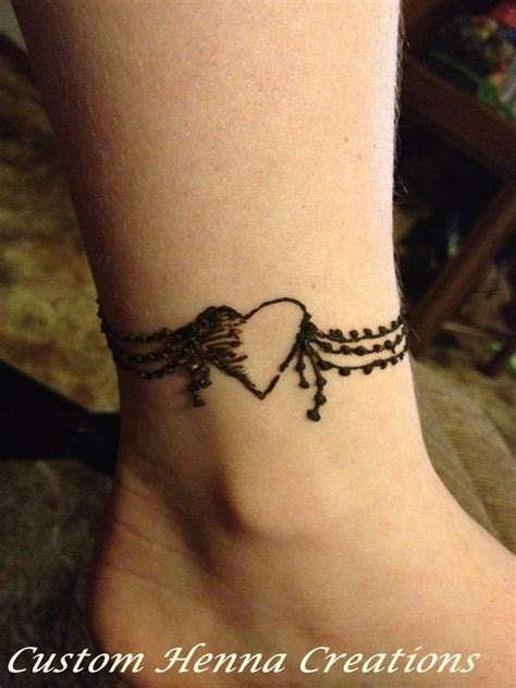 henna on ankle mehndi heart wrap around design on child
