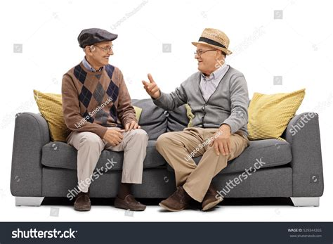 couch for men two elderly men sitting on sofa stock photo 529344265