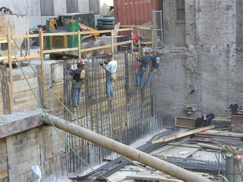 ironworkers assembling rebar for a wall construction