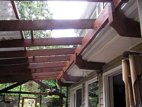 pergola attached to roof attach pergola to house roof is the way it s