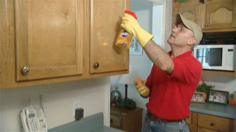 best product to clean kitchen cabinets how to remove grease from kitchen cabinets today s homeowner