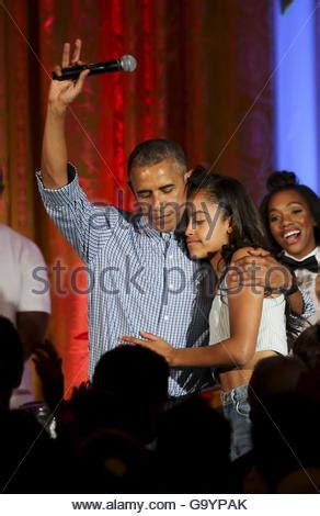 president barack obama hugs daughter malia as first lady