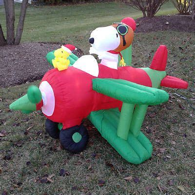 northpole airlines snoopy woodstock airblown inflatable christmas plane woodstock planes