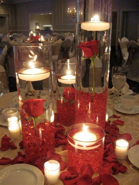 wedding centerpieces with candles and water gorgeous stem roses fully immersed in water with