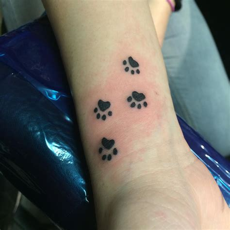 paw print tattoos on wrist 27 wrist designs ideas design trends premium
