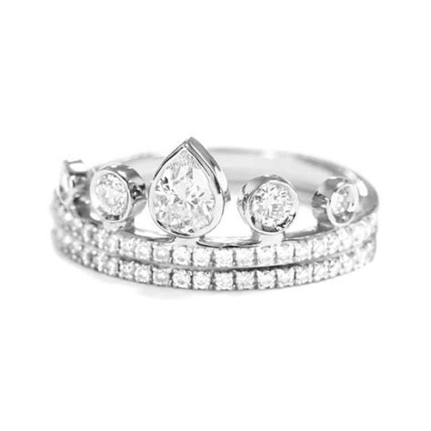 pear crown engagement ring with matching eternity