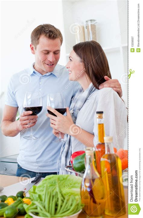 romantic couple drinking wine romantic couple drinking wine while cooking royalty free