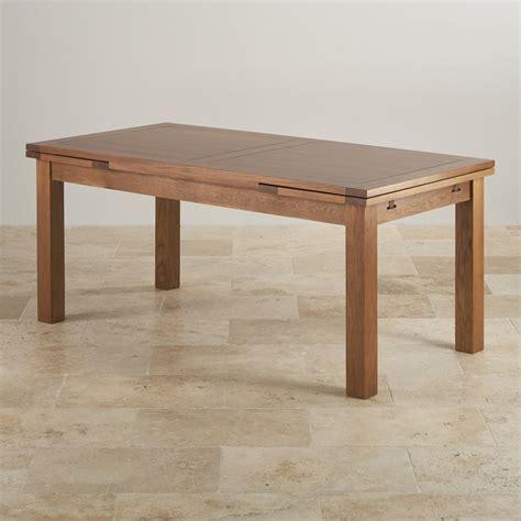 solid oak extending dining table extending dining table in rustic oak oak furniture land