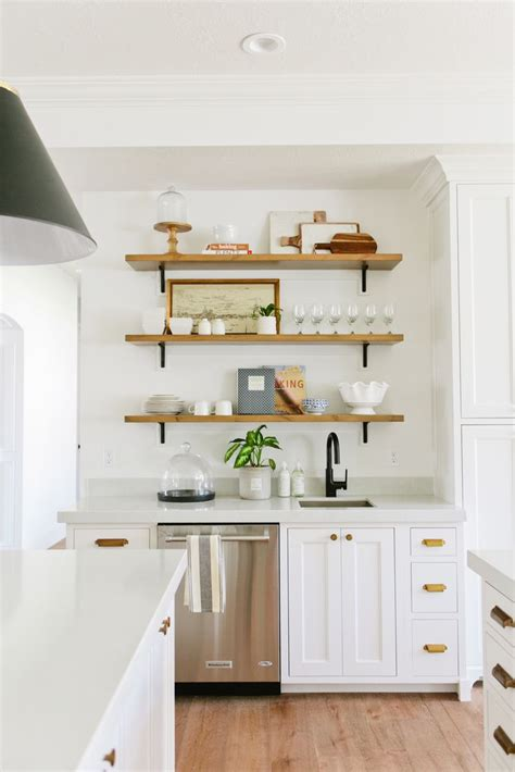 kitchen open shelving white kitchen cabinets brass pulls floating wood shelves