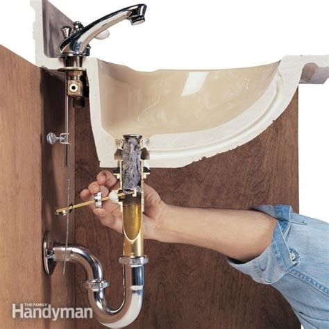 how to snake bathroom sink how to clear clogged drains the family handyman