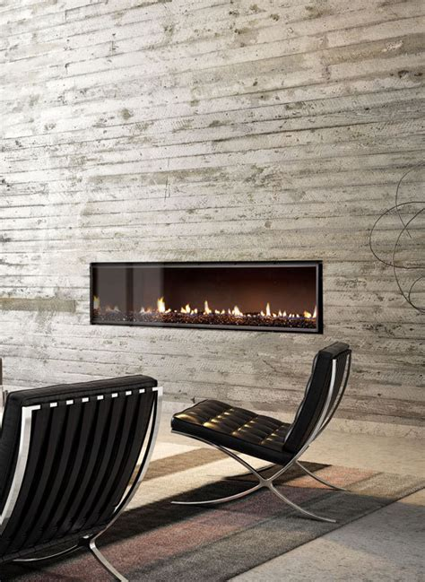ultra wide gas fireplace as a central feature in a