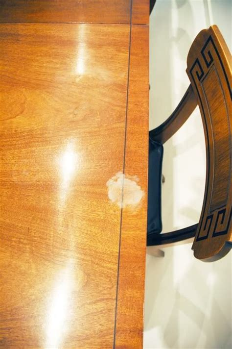 how to get stains out of wood table how to get that heat stain out of your wood our dining