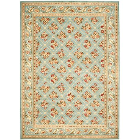 blue rugs 6 safavieh lyndhurst blue 6 ft 7 in x 9 ft 6 in area rug lnh556 6565 7 the home depot