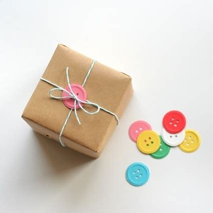 use handmade paper buttons to wrap up a gift
